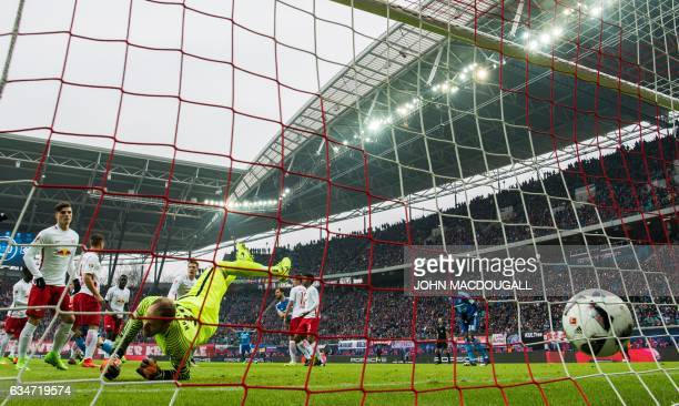 Leipzig's Hungarian goalkeeper Peter Gulacsi fails to save the ball fo the 01 goal during the German First division Bundesliga football match RB...