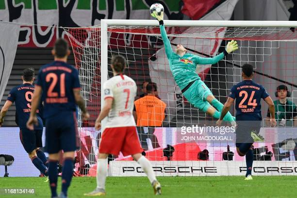Leipzig's Hungarian goalkeeper Peter Gulacsi makes a save during the German first division Bundesliga football match RB Leipzig v FC Bayern Munich in...
