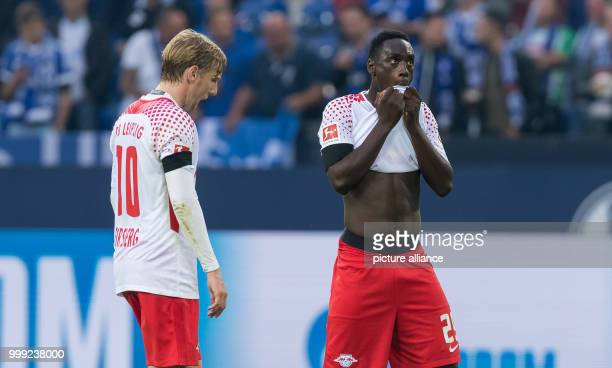 Leipzig's JeanKevin Augustin and Emil Forsberg stand on the pitch after the German Bundesliga soccer match between FC Schalke 04 and RB Leipzig in...