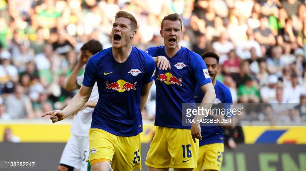 Leipzig's Marcel Halstenberg and Marcel Sabitzer celebrate the 01 goal against Moenchengladbach during the German first division Bundesliga football...