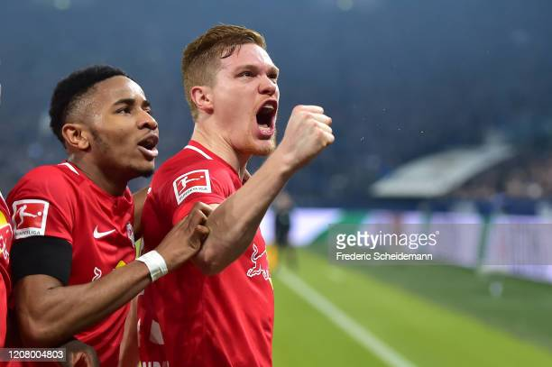 Leipzig's Marcel Halstenberg celebrates with teammates after scoring his team´s third goal during the Bundesliga match between FC Schalke 04 and RB...