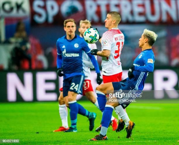 Leipzig´s midfielder Diego Demme Schalke´s defender Bastian Oczipka and Moroccan midfielder Amine Harit vie for the ball during the German first...