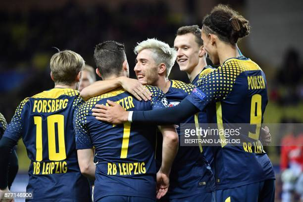 Leipzig's players celebrate after Monaco's Brazilian defender Jemerson scored a goal against his team during the UEFA Champions League group G...