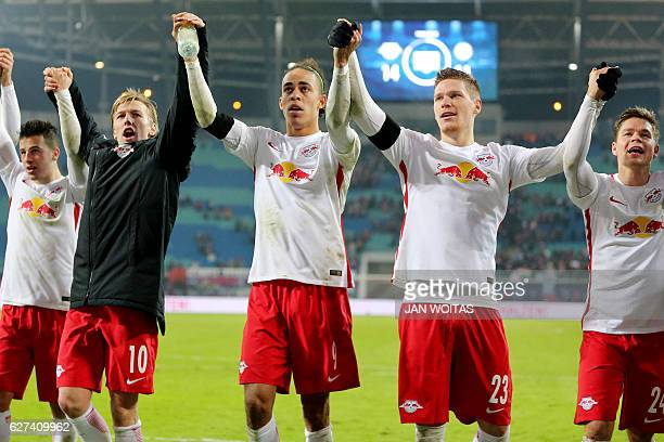 Leipzig's players celebrate after the German first division Bundesliga football match between RB Leipzig and Schalke 04 in Leipzig eastern Germany on...