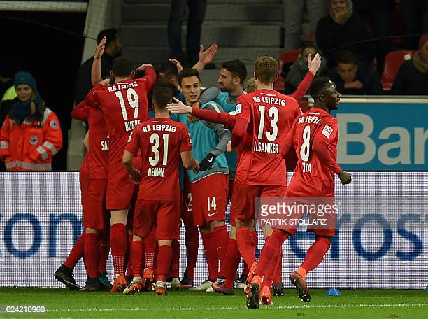 Leipzig´s players celebrate during the German first division Bundesliga football match of Bayer Leverkusen vs RB Leipzig in Leverkusen western...