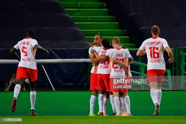 Leipzig's players celebrate their opening goal scored by Leipzig's Spanish midfielder Dani Olmo during the UEFA Champions League quarter-final...