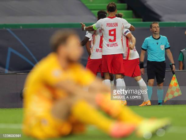 Leipzig's players celebrate their second goal scored by US midfielder Tyler Adams during the UEFA Champions League quarter-final football match...