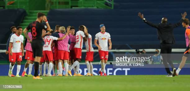 Leipzig's players celebrate their win at the end of the UEFA Champions League quarter-final football match between Leipzig and Atletico Madrid at the...