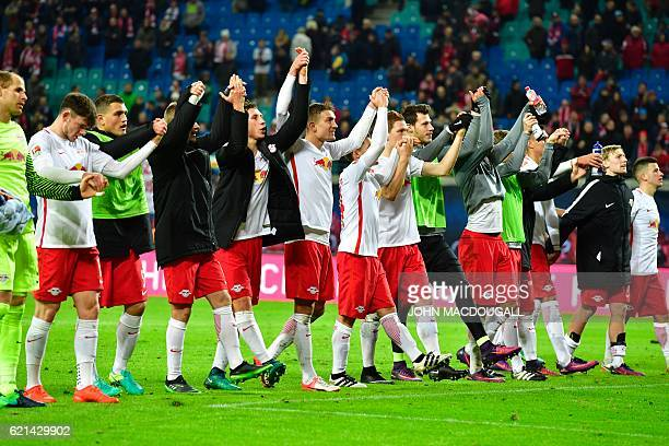 Leipzig's players celebrate with the fans after the German first division Bundesliga football match between RB Leipzig and Mainz 05 in Leipzig...