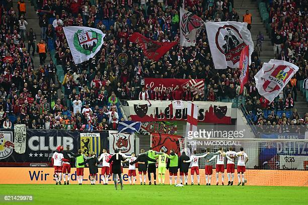 Leipzig's players celebrate with their fans after the German first division Bundesliga football match between RB Leipzig and Mainz 05 in Leipzig...