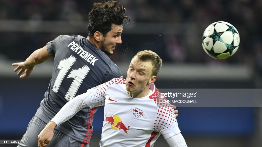 Leipzig's Portuguese midfielder Bruma (R) and Besiktas' forward Mustafa Pektemek vie for the ball during the UEFA Champions League group G football match RB Leipzig vs Besiktas in Leipzig, eastern Germany, on December 6, 2017. / AFP PHOTO / John MACDOUGALL
