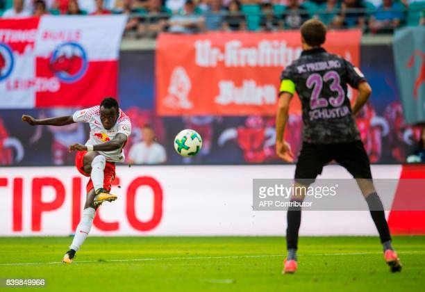 Leipzig's Portuguese midfielder Bruma scores next to Freiburg´s midfielder Julian Schuster the fourth goal for his team during the German first...