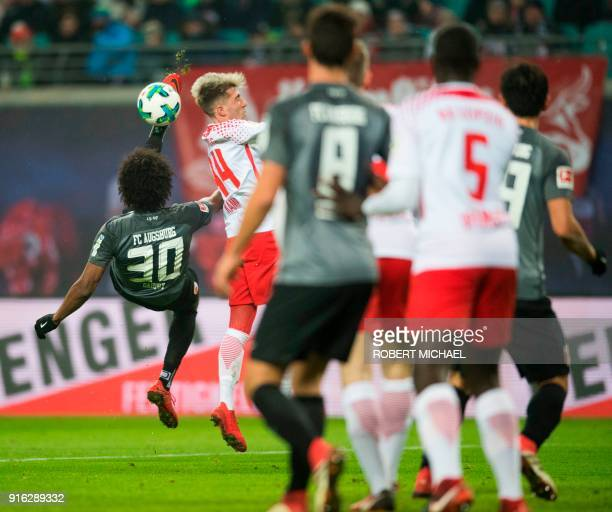 Leipzig´s Slovanian midfielder Kevin Kampl and Augsburgs´s Brazilian midfielder Caiuby vie for the ball during the German first division Bundesliga...