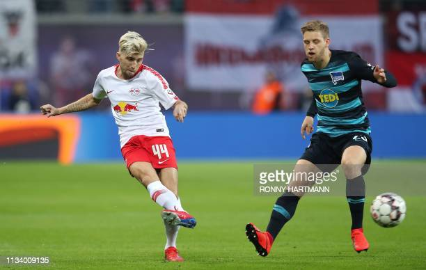 Leipzig's Slovanian midfielder Kevin Kampl and Berlin's German midfielder Arne Maier vie for the ball during the German first division Bundesliga...