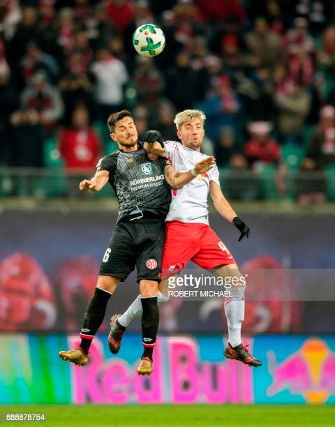 Leipzig's Slovanian midfielder Kevin Kampl and Mainz' German midfielder Danny Latza vie for the ball during the German first division Bundesliga...