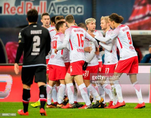 Leipzig's Slovanian midfielder Kevin Kampl celebrates with teammates after scoring the 10 during the German first division Bundesliga football match...