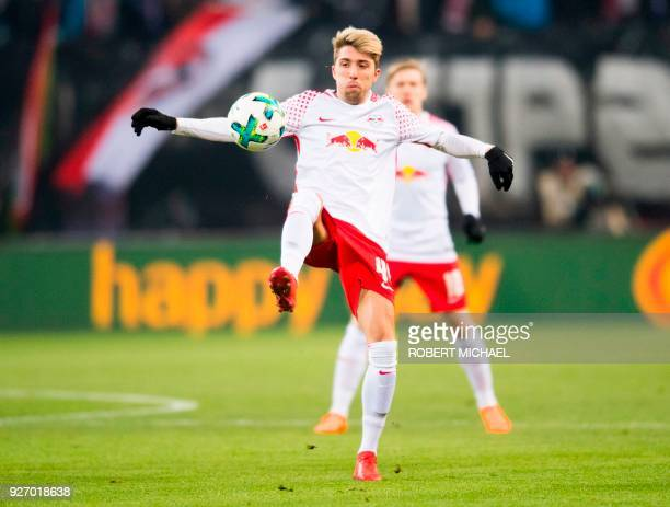 Leipzig's Slovanian midfielder Kevin Kampl plays the ball during the German first division Bundesliga football match RB Leipzig vs Borussia Dortmund...