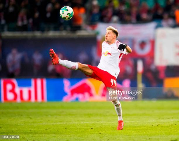 Leipzig's Slovanian midfielder Kevin Kampl plays the ball during the German first division Bundesliga football match between RB Leipzig and FC Bayern...