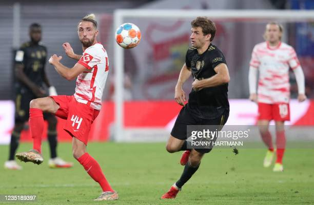 Leipzig's Slovenian midfielder Kevin Kampl and Bayern Munich's German forward Thomas Mueller vie for the ball during the German first division...
