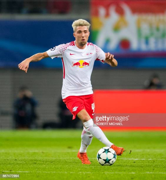 Leipzig's Slovenian midfielder Kevin Kampl plays the ball during the UEFA Champions League group G football match RB Leipzig vs Besiktas in Leipzig...
