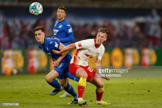 Leipzig's Spanish midfielder Dani Olmo and Hoffenheim's Austrian midfielder Christoph Baumgartner vie for the ball during the German first divison...
