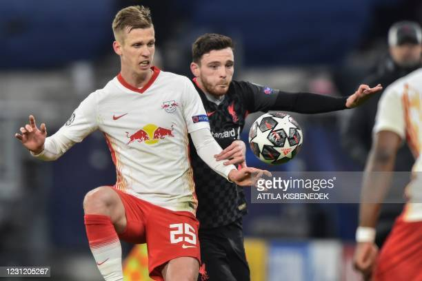 Leipzig's Spanish midfielder Dani Olmo and Liverpool's Scottish defender Andrew Robertson vie for the ball during the UEFA Champions League round of...