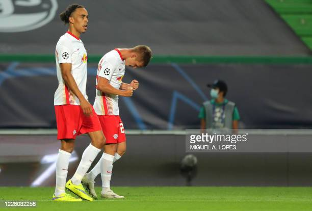 Leipzig's Spanish midfielder Dani Olmo celebrates after scoring a goal during the UEFA Champions League quarter-final football match between Leipzig...