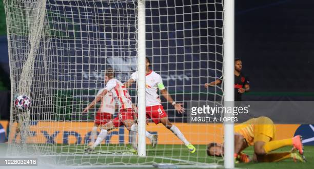 Leipzig's Spanish midfielder Dani Olmo scores a goal during the UEFA Champions League quarter-final football match between Leipzig and Atletico...