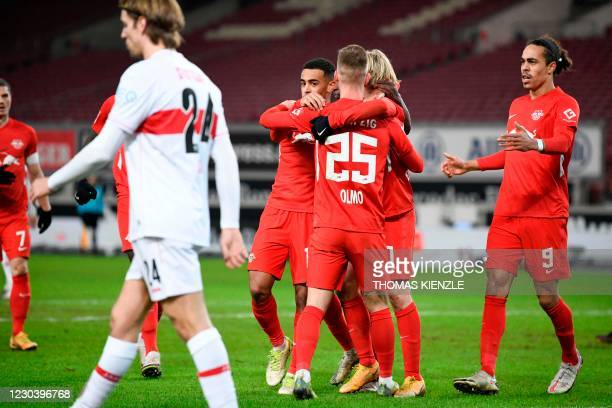 Leipzig's Spanish midfielder Olmo Dani celebrates with teammates after he scored the 1-0 goal during the German first division Bundesliga football...