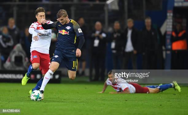 Leipzig´s striker Timo Werner and Hamburg's Japanese defender Gotoku Sakai vie for the ball during German first division Bundesliga football match...