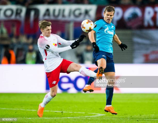 Leipzig's Swedish forward Emil Forsberg and Saint Petersburg's forward Aleksandr Kokorin vie for the ball during the Europa League Round of 16 first...