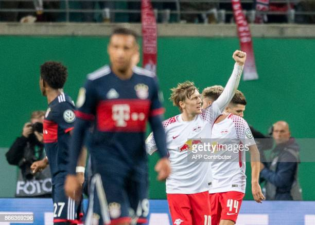 Leipzig´s Swedish forward Emil Forsberg celebrates scoring with his teammate during the German Cup football match RB Leipzig v FC Bayern Munich in...