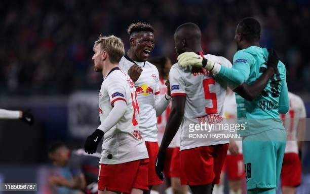 Leipzig's Swedish forward Emil Forsberg celebrates with French defender Nordi Mukiele French defender Dayot Upamecano and French goalkeeper Yvon...