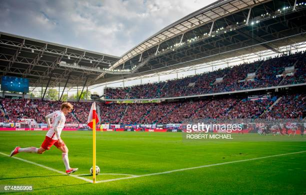 Leipzig´s Swedish forward Emil Forsberg takes a corner kick during the German first division Bundesliga football match between RB Leipzig and FC...
