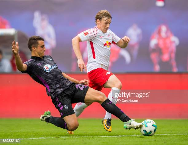 Leipzig's Swedish midfielder Emil Forsberg and Freiburg's defender MarcOliver Kempf vie for the ball during the German first division Bundesliga...