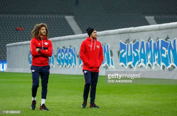 Leipzig's Swedish midfielder Emil Forsberg and Leipzig's Welsh defender Ethan Ampadu inspect a mock-up of the former Berlin Wall bearing the...