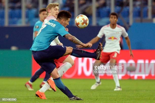 Leipzig's Swedish midfielder Emil Forsberg and Zenit St Petersburg's midfielder from Argentina Matias Kranevitter vie for the ball during the UEFA...