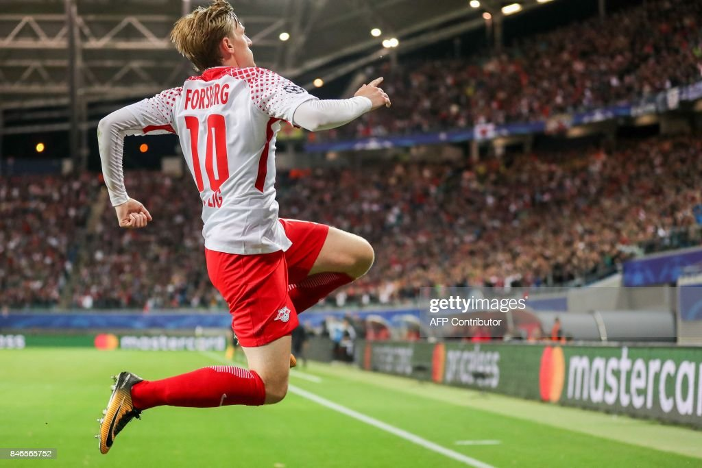 Leipzig's Swedish midfielder Emil Forsberg celebrates scoring the opening goal during the UEFA Champions League group G football match RB Leipzig v AS Monaco in Leipzig, eastern Germany on September 13, 2017. / AFP PHOTO / dpa / Jan Woitas / Germany OUT