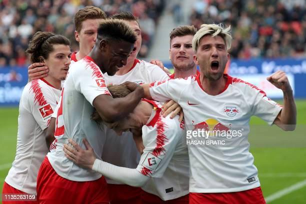 Leipzig's Swedish midfielder Emil Forsberg celebrates scoring with his teammates during the German first division Bundesliga football match between...
