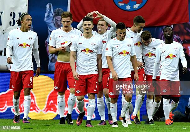 Leipzig's Swedish midfielder Emil Forsberg makes a hearsign after scoring the second goal during the German first division Bundesliga football match...