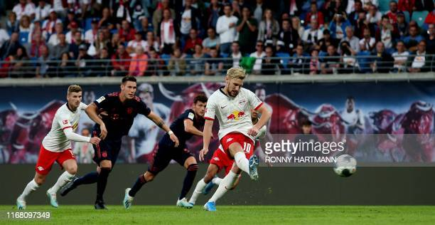 Leipzig's Swedish midfielder Emil Forsberg scores the 11 equalizer from the penalty spot during the German first division Bundesliga football match...
