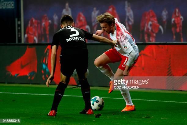 Leipzig's Swedish midfielder Emil Forsberg vies with Leverkusen's Greek defender Panagiotis Retsos during the German first division Bundesliga...
