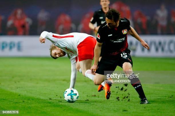 Leipzig's Swedish midfielder Emil Forsberg vies with Leverkusen's Austrian midflielder Julian Baumgartlinger during the German first division...