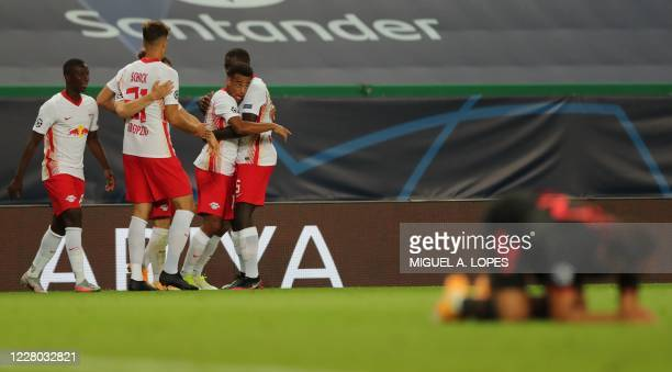 Leipzig's US midfielder Tyler Adams celebrates after scoring a goal during the UEFA Champions League quarter-final football match between Leipzig and...