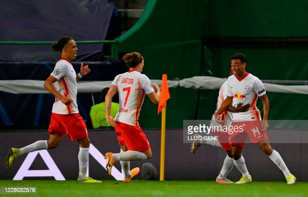 Leipzig's US midfielder Tyler Adams celebrates his goal with teammates during the UEFA Champions League quarter-final football match between Leipzig...