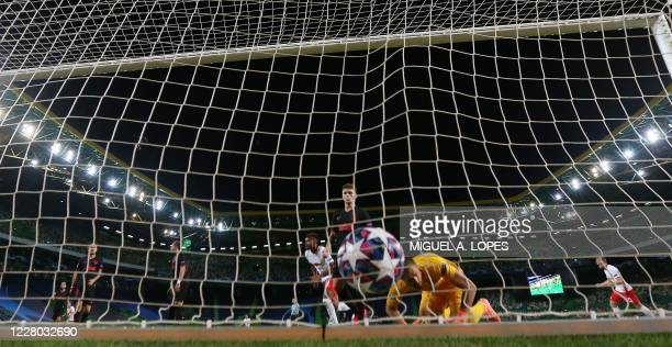 Leipzig's US midfielder Tyler Adams scores his goal during the UEFA Champions League quarter-final football match between Leipzig and Atletico Madrid...