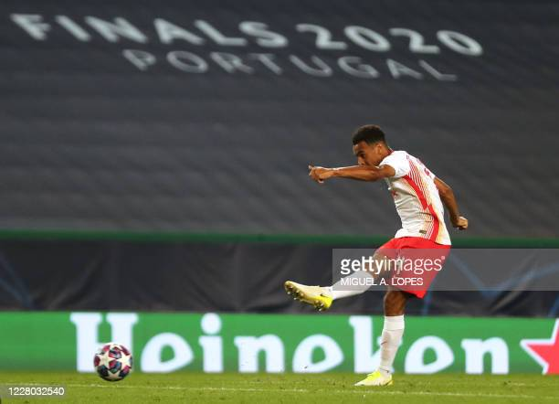 Leipzig's US midfielder Tyler Adams shoots to score his goal during the UEFA Champions League quarter-final football match between Leipzig and...