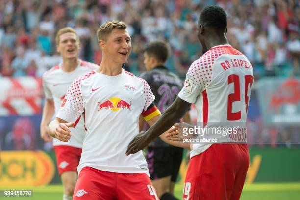 Leipzig's Willi Orban celebrating after his scoring of the 21 with JeanKevin Augustin during the RB Leipzig vs SC Freiburg Bundesliga match in the...