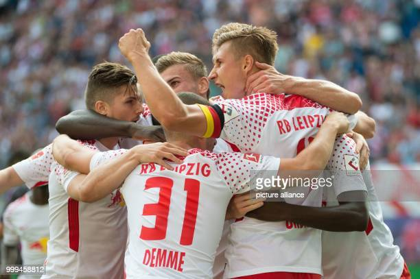 Leipzig's Willi Orban celebrating with teammates after his scoring of the 21 during the RB Leipzig vs SC Freiburg Bundesliga match in the Red Bull...
