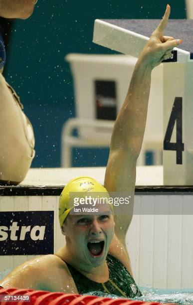 Leisel Jones of Australia celebrates after winning the gold medal in a new world record time in the women's 100m breaststroke final at the swimming...